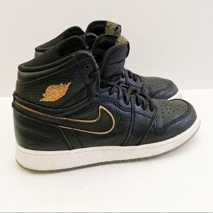 Nike Air Jordans Black with gold youth